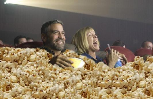 george-clooney-eating-popcorn-at-movies